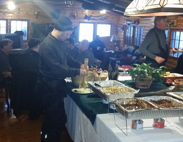 image of a group of snowmobilers eating Lodge buffet