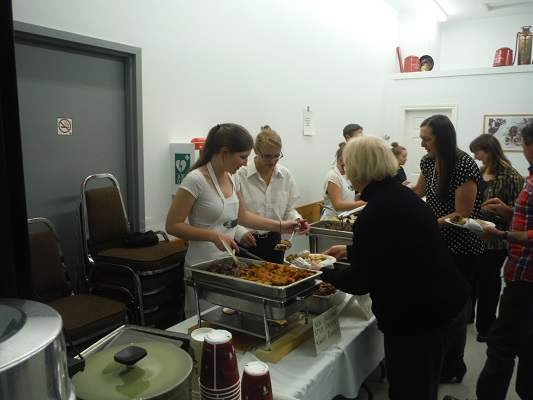 photo of Cindy helping to serve at Wild Game Dinner