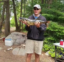 photo of man on Lunch Island with big pickerel he has caught