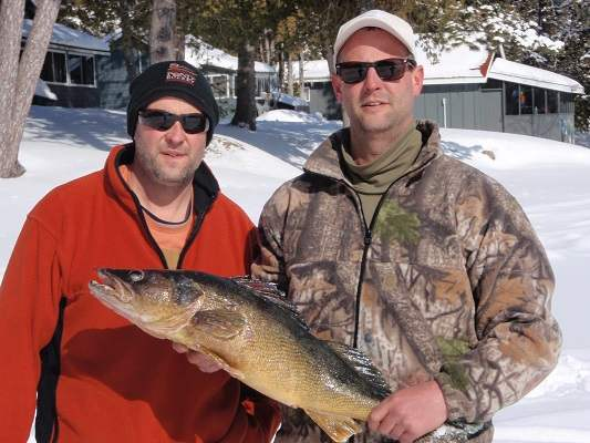 image of in front of Lake Herridge Lodge in winter with large pickerel