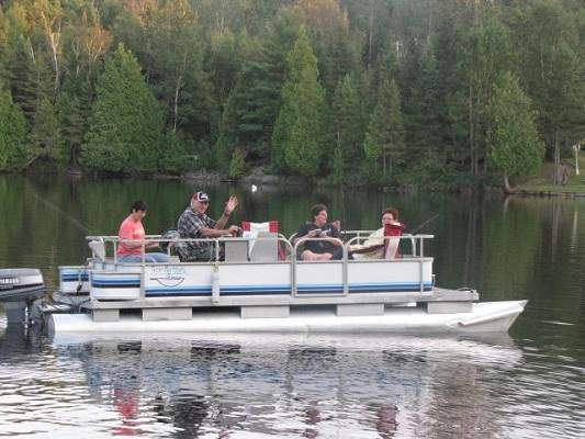 photo of five people in pontoon boat