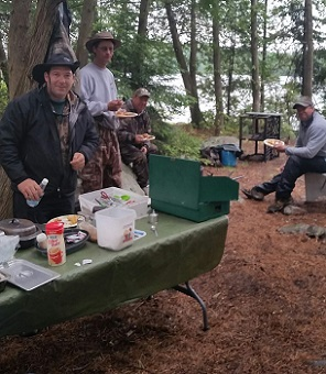 photo of men eating shore lunch on Lunch Island