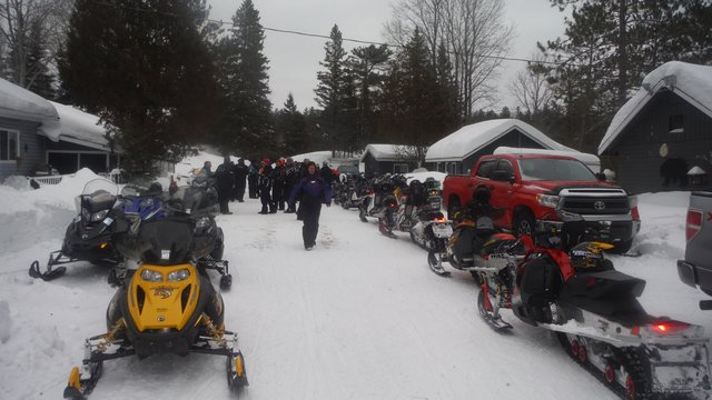 photo of a large group of sledders and their sleds at Lake Herridge Lodge