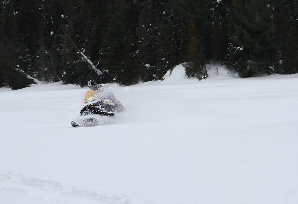 image of a sledder going fast on a frozen lake