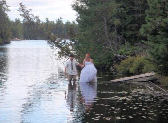 photo of a bride and groom on a dock