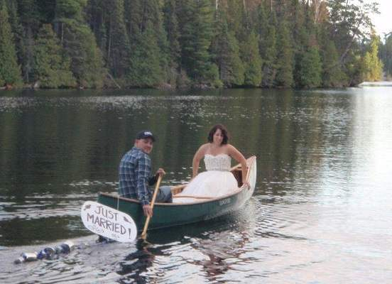 image of a bride and groom in a canoe that says Just Married