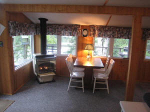 cottage eight dining area and gas fireplace