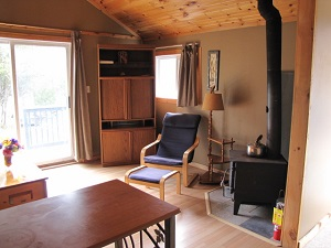 cottage ten living room with woodstove