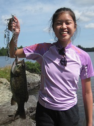 photo of girl holding up large bass