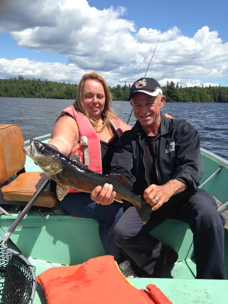 photo of man and woman in boat with large pickerel