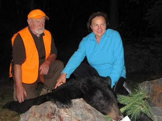 photo of man and woman with harvested bear