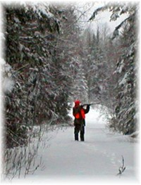 photo of small game hunter in snowy woods